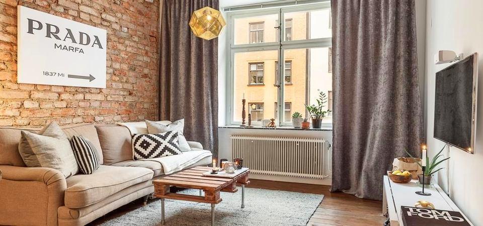 Маленькая квартира-студия с кирпичными стенами