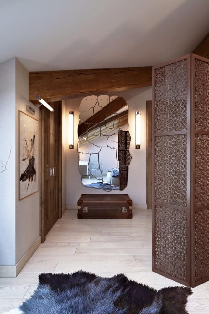 При входе в спальню кровать прикрывает воздушная ширма с изящным восточным рисунком. По правую руку находится отдельная гардеробная и большое необычное зеркало в стиле лофт. Различные стили смешались, но всё уравновешено колористическим решением.