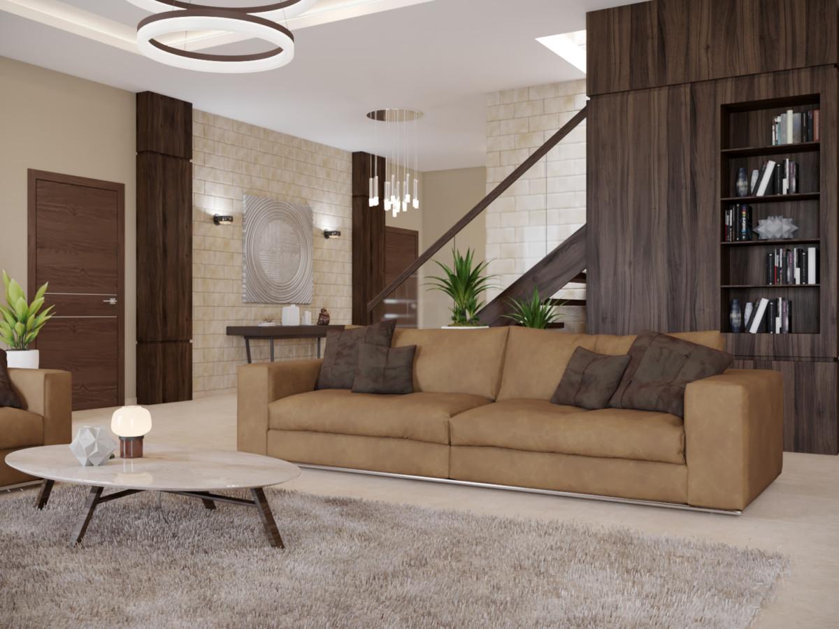 В зоне гостиной расположили два больших дивана в обивке из кожи.