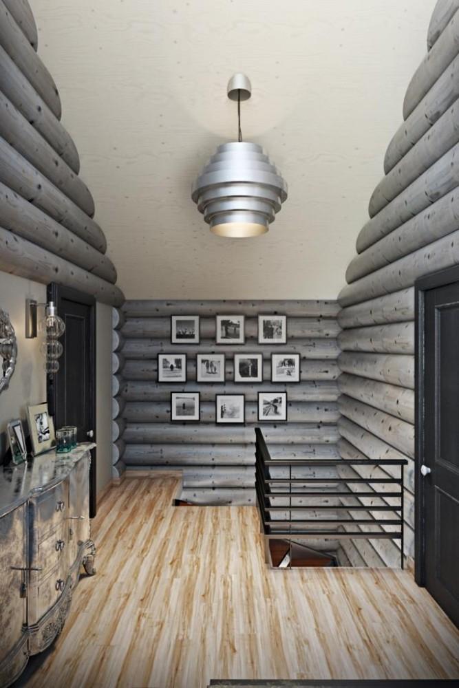 Стены выкрашены колерованным в серый цвет маслом. С оттенком пришлось повозиться и сделать далеко не один образец, но результат стоил усилий. Это пространство является холлом, где присутствует металл черного цвета и деревянные двери. Для украшение, мы взяли серебристую текстуру и представили в виде осветительных приборов и мебели